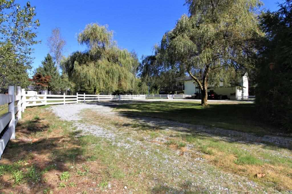 ENJOY THE COUNTRY LIFE - 2 LEVEL ACRES ON CITY WATER...... just minutes to town, schools, shopping and recreation. This 2 storey offers 4 bedrooms, 3 baths,  new flooring, updated kitchen and baths, generous room sizes, family and recreation rooms.....lots of parking for RV. All usable land......and set on a dead end street.