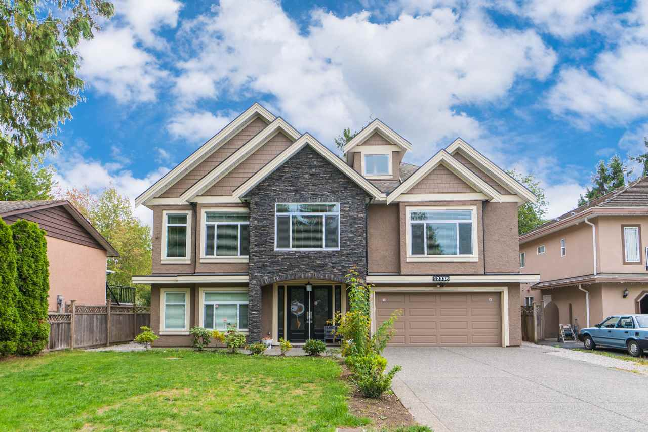 This high quality custom built home sits on a rectangle north-south facing lot on a quiet Cul-de-sac in a prestigious neighborhood. 5 spacious bedrooms and 5 bathrooms on the main floor, and a huge media room on ground floor for owner family uses. A 2-bedroom suite and a 1 -bedroom suite, both with separate entry, provide excellent mortgage helpers. Radiant heat, air-conditioning, HRV, stainless steel appliances, separate wok kitchen... This craftsman home boasts many features that make it a lovely place for everyday living as well as great entertainment. Close to park and within walking distance to elementary and secondary schools, move in with your family today and watch your children grow! open house Oct 15 2-4pm