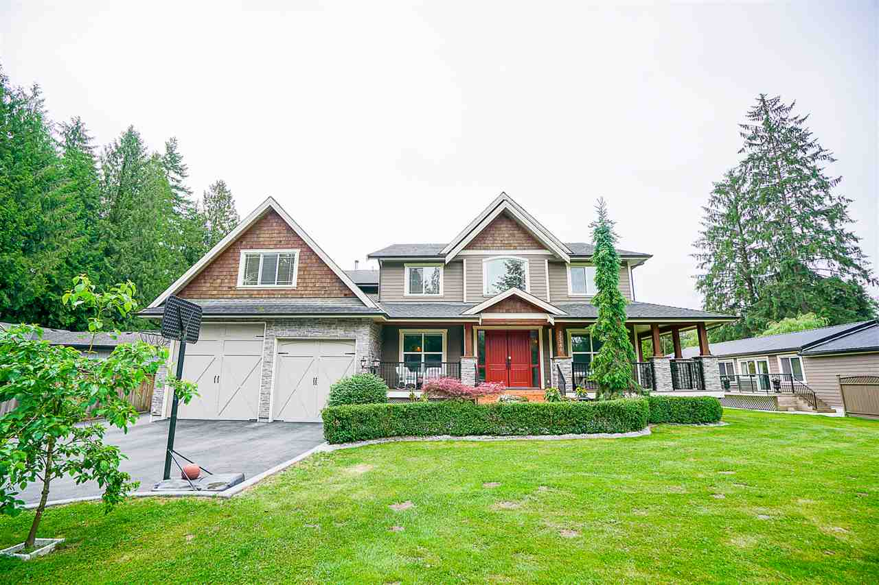 Custom-Built Executive Home on 2.06 Acres. WATERFRONT property w/ PRIVATE BEACH for picnics, sun tanning & swimming. Alouette River runs through property making this beautiful PARK-LIKE SETTING. Away from hustle & bustle yet only 10 min walk to downtown Maple Ridge. Breathtaking PRIVACY & RIVER VIEWS! Gated residence w/ 5 beds & 5 baths, gym, theatre room, 6 car garage, vaulted ceilings & AC. Kitchen w/ centre island, granite, double ovens, wine fridge & bar. ULTRA LUXURY throughout! Sundeck facing river w/ hot tub, outdoor bar & kitchen. Property has coach home plus another 2 bed, 2 bath home. Property suitable for up to 4 families. Located only few blocks from prestigious MEADOWRIDGE PRIVATE SCHOOL. This is your OUTDOOR OASIS!