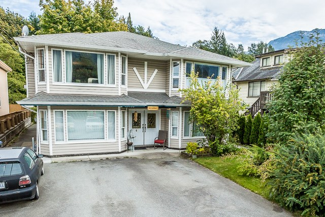 This is an amazing investment opportunity you don't want to miss! With an ideal location close to downtown Squamish and beautiful mountain views. This home/duplex has 6 bedrooms, 5 full bathrooms, a covered sundeck that faces a private green space, ample parking both in the front and back. A fully separate 2 bedroom legal suite rented for $1,500 also has its own metered utilities. A one bedroom in-law suite and a third separate entry space for even a student! Open House: Sat, Sept 30th, 1:00-3:00 PM.