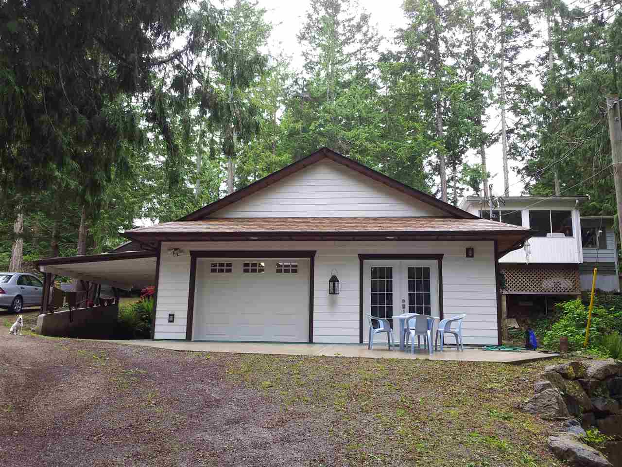 This 2 bedroom, 2 bath manufactured home includes vaulted ceilings, large open living room, dining and family rooms. There is a big deck on the front of the home with an enclosed hot tub room, and covered porch on the back. The new 30x30 garage and carport includes a studio. This prime cul-de-sac location is a 10 for neighbourhood, and the lot is beautiful with huge mature cedars. There is an RV parking spot in addition to the 2 covered parking spots. The beach is only 1.5 blocks away as well as John Henry's marina and LaVernes bar and Grilll and 4 lakes close by for swimming or fishing.