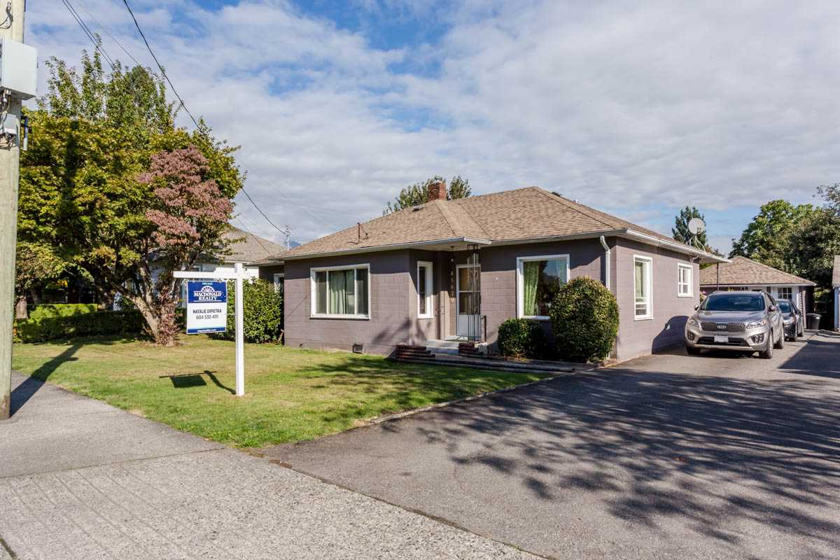 CUTE AS A BUTTON, 3 bedroom, 2 baths rancher in the heart of Chilliwack!! This beautiful home features 9 ft. ceilings, hardwood flooring, new tile flooring in the kitchen and bathrooms, newer windows, a new dishwasher, a skylight in the bathroom, and an awesome 12 x 20 deck in your fully fenced backyard!! BONUS: A detached garage converted into a hair salon. This home is perfect for a first time buyer or investor! You will love this home and the central location, don't miss out and call today!!