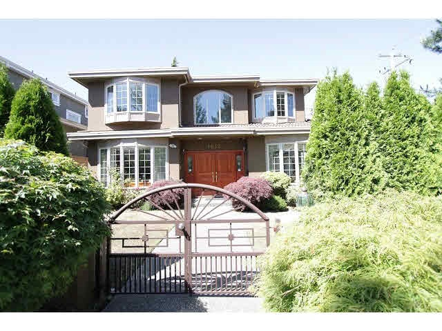 Quality built & well kept 6 bedroom house in prime South Granville area. Beautiful & contemporary 2 lvls w/bsmt home with over 3,700 sq ft sit on a nice lvl lot over 6,200 SF situated at quiet side but convenient loc. Sound Const. Top quality & craftsmanship feats 6 bdrms, 5 baths & den, sauna room & good sized laundry room, etc. Excellent value for this immaculate well maintained home w/spacious & functional layout, spacious high ceiling entrance, 4 bdrms up w/2 ensuites. 2 bdrms, sauna rm & recreation room in the basement. All floors radiant heated, security system, triple garage. Covered deck at the backyard. Beautiful landscaping w/lawn sprinkler, close to all amenities, trans, community ctr, schools.  Open house Sat Oct 14  from 2:15 to 4:15 pm