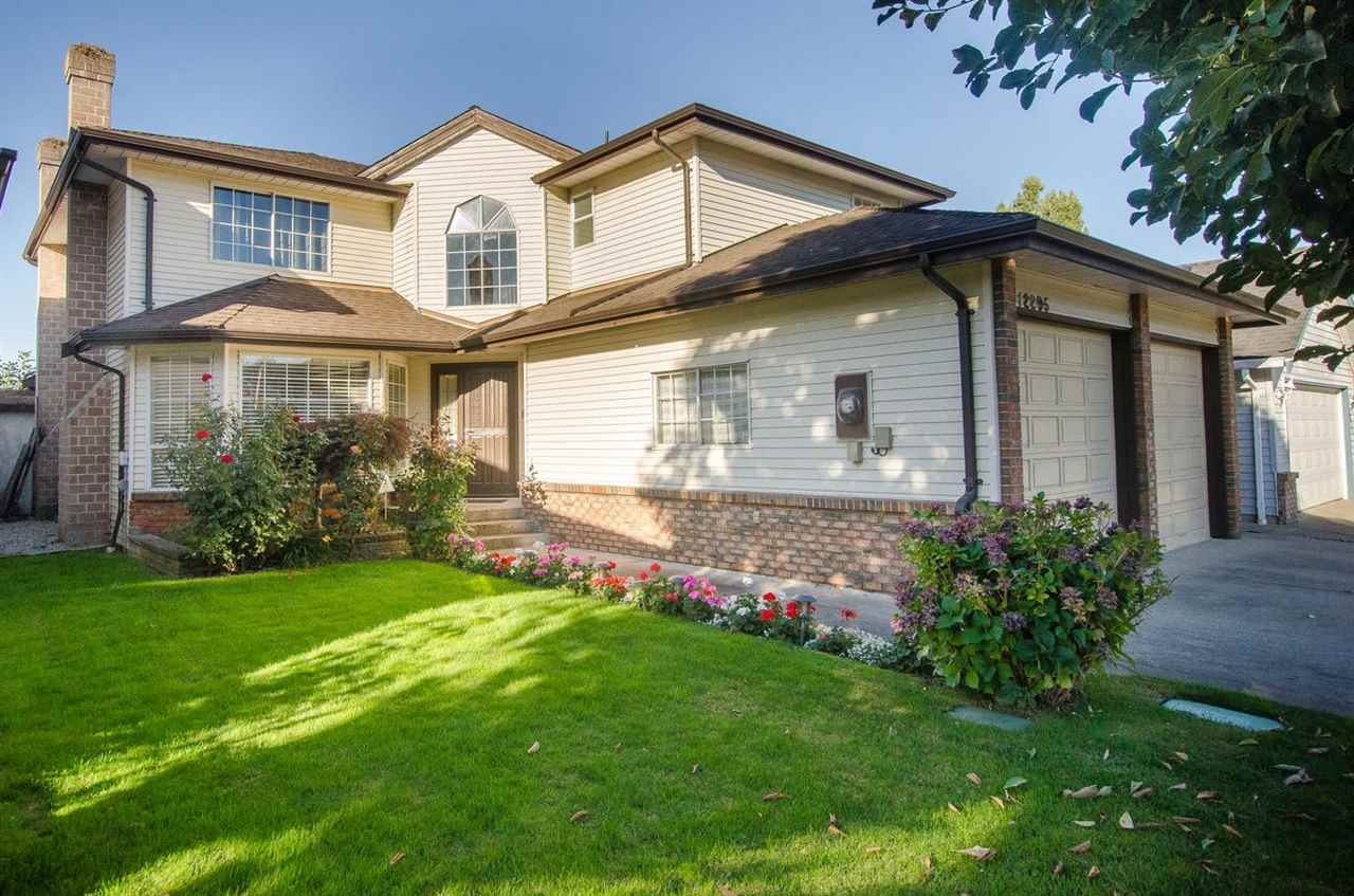 IT'S FAMILY APPROVED! Matchless! Meticulous! Memorable! Outstanding family home in a child-safe neighbourhood & walking distance to Mitchell Elementary School. Long list of improvements including kitchen & appliances, granite counter tops, large island with sink, bathrooms, windows, Brazilian hardwood flooring, crown molding, roof, furnace, hot water tank, built-in vacuum, security system & more....Wall to wall spaciousness with large family room off the kitchen and 4 bedrooms upstairs. Fully fenced and easy access backyard plus extra high ceiling in garage for extra storage. European built, one owner home in meticulous condition...just move-in!