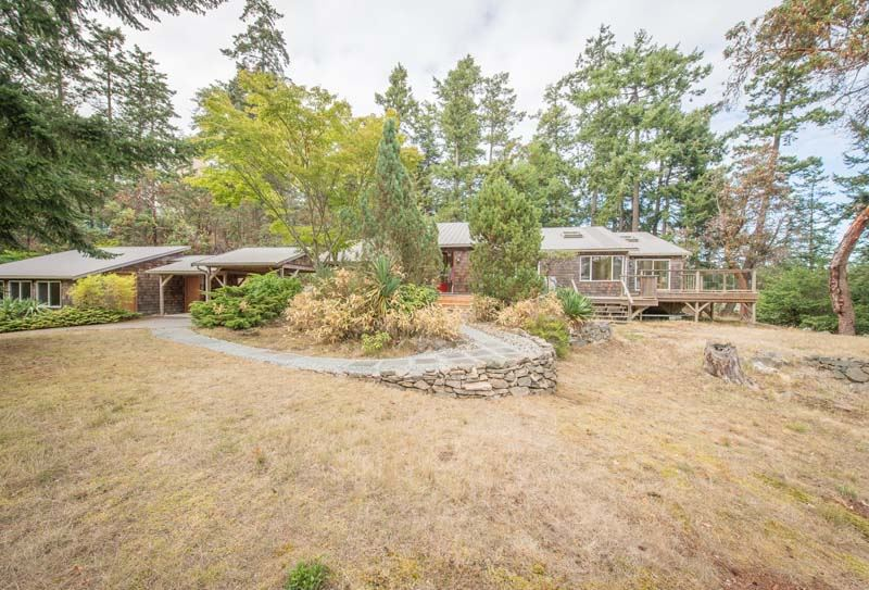 A very beautiful ocean view residence in prime Scott Point area of special Salt Spring Island. Totally renovated 'West Coast contemporary' style 3 bed/3 bath home. In essence a 'new house'. Architect designed, showing welcoming features by Seattle architect & local customer builder in 2008. Sunny, private tranquil with ocean view of both Long Harbour & Ganges Harbour. A separate studio space would suit artist or home occupation. Just 'move in', mint condition, ready to enjoy! Natural landscaping, trees, knolls & lots of decking invite contemplation.  A GEM!
