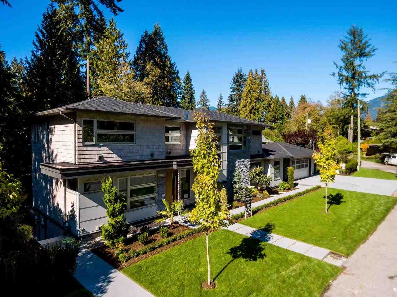 This impressive modern classic offers 5400 sq ft over 3 levels and is located on a private Edgemont street boasting 163 ft of frontage and triple car garage. Features include endless h/w floors, large dining, spacious living with ear to ear gas fireplace and eclipse doors leading to a covered patio with B/I BBQ centre. The large kitchen ( has separate wok kitchen too) boasts Sub-Zero and Wolf appliances and large island adjoining eating area and family room with eclipse patio doors leading out a spacious patio. Upstairs offers 4 bedrooms that include a huge master with w/I closet and gorgeous 5 piece ensuite. Entertain downstairs with rec. media, games, guest bdrm and wine room. Very private rear yard with a nice water feature. A step above the rest! Open Sunday October 22nd 2-4