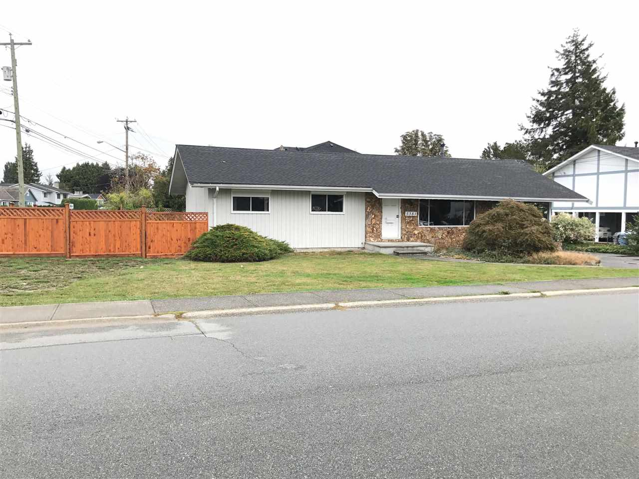 HUGE CORNER LOT, 10,003 square feet,  with a cozy rancher. Located just minutes from Ladner Village in Central Ladner and close to Hawthorne Elementary, and a short drive to new Mall development and to highways to Richmond and Vancouver. Potential to build a 4,000 square foot house with a detached garage, inquire with City Hall. Viewings by appointment. All sizes and ages are approximate, buyer or buyers agent to verify if deemed important.