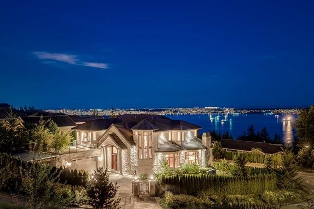 Stunning ocean view custom built home sitting on a rare level lot. Amazing views of downtown, harbor, and ocean. Lots outdoor space and professionally landscaped south-facing yard. Secure gate and a level driveway lead to a grand entry. Exceptional quality and details on limestone flooring and beautiful high-end windows/doors. A private elevator to all 3 levels. Enjoy indoor swimming pool all season long. A short walk highly ranked Collingwood Junior School. Luxury European style with elegant touches.