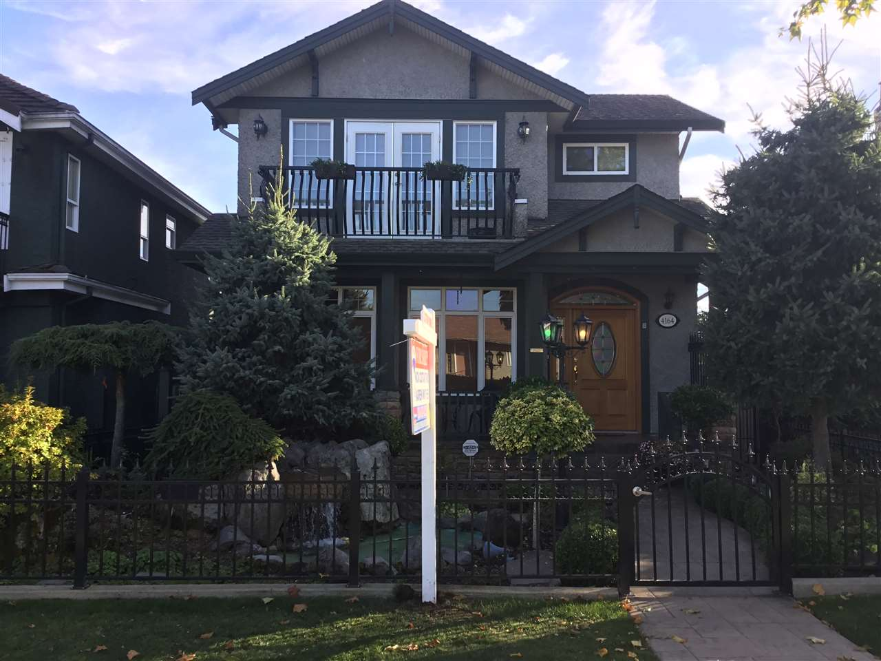 FIRST TIME ON THE MARKET - The perfect address close to everything but on nice quiet street for children. Custom built Italian inspired 2 storey plus basement featuring 3 bdrms (one on the main), formal liv and din rm with f/p, open kitchen with island S/S appls and fam rm with f/p.Rec rm and wine rm down with private outside entrance.High end finishing throughout with granite counters and island, ceramic tile and hardwood floors, high ceilings lots of cherry wood cabinets and so much more.Double garage, stamped concrete patios/walkways and amazing gardens, decorative pond, front and back fenced with iron picket fence and gates.Pride of ownership shows through - you will want to live here once you see it!!! Call today for a private showing.Very flexible possession.