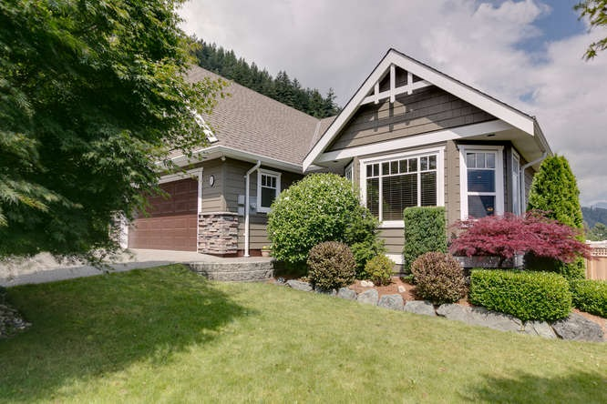 This beautiful custom built home is located in Harrison Mills at the famous Sasquatch Inn turn off just a 1/2 km past the Sand Piper Golf Course & Restaurant. 1852 sq. ft. Rancher style home with a loft. Home is built to perfection with a huge master bedroom, en-suite & walk-in closet plus 2 more extra bedrooms on the main floor & bonus Media room above over-sized garage. Perfectly designed & finished home with bamboo hardwood and tile flooring throughout the main floor, open concept Kitchen, Dining Room, Living Room. Custom kitchen cabinets, designer appliances and a gorgeous eating bar, all opening onto a very spacious deck with awesome views of the local mountains. Landscaped & fenced yard. Central air, with a high-efficiency heat pump.  Virtual/Toured & Laser/Measured