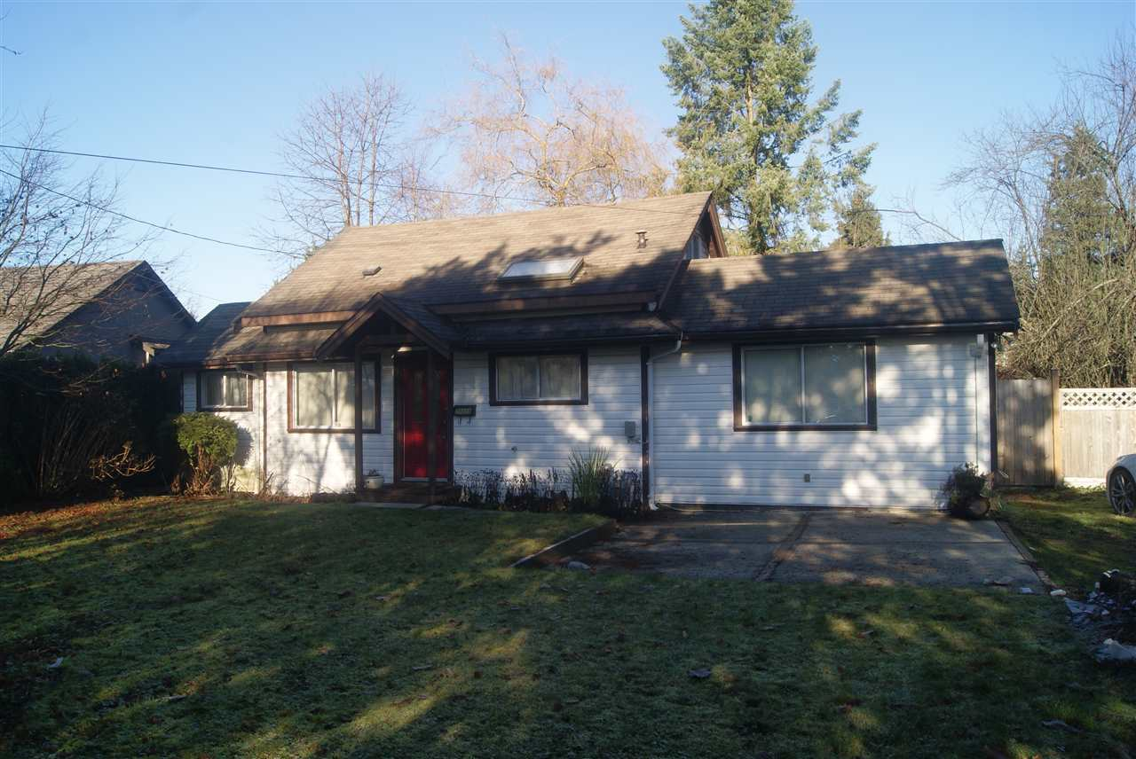West side 1/4 acre lot (approx) 10,730 sqft. Features updated rancher, located near elementary school and transit. Property has potential to be rezoned to RT-1 to build a new duplex.
