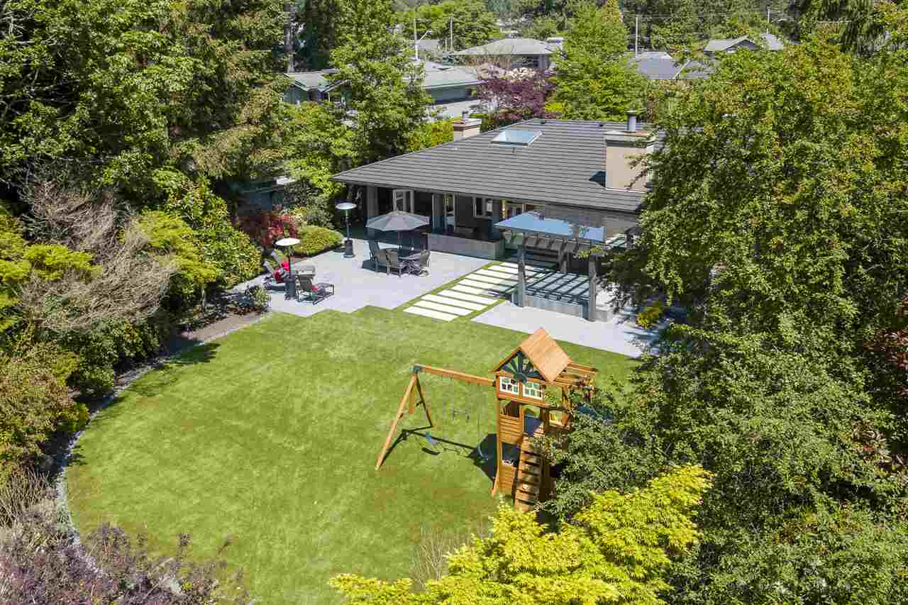 """THE BEST OF EDGEMONT?-This is a TRULY SPECTACULAR estate-like property with an elegant, timeless approx. 5300 sq.ft home, sitting on an exceptional 17,000 sq.ft private, flat lot on CRESCENTVIEW DRIVE in the HEART OF EDGEMONT.  This one of a kind residence boasts a spacious main living area opening to the magical sunny, south-facing backyard with beautifully landscaped gardens, covered hot tub and outdoor kitchen area-ideal for entertaining where kids and friends can play forever.  Three bedrooms up including the spacious master bedroom with a luxurious ensuite. The lower level offers two more bedrooms, a large gym, hobby room, media room, wine cellar and recreation room. Situated just two blocks to the Village and in the Highlands and Handsworth catchment."