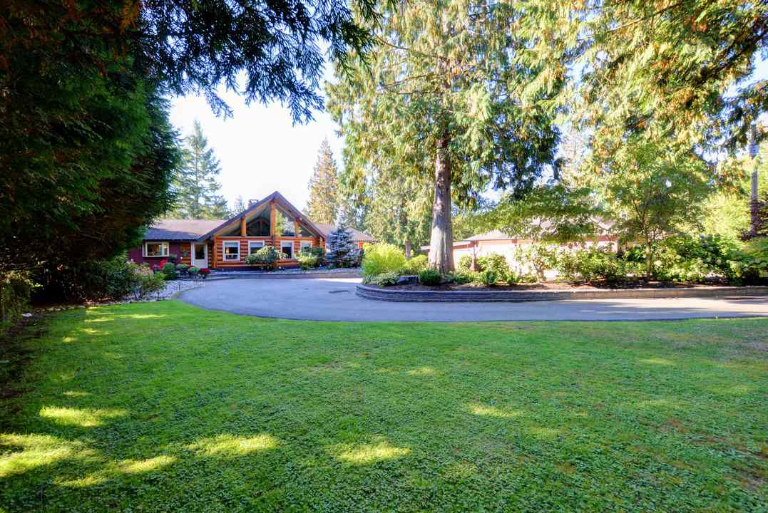 You will love this luxury log home that is nestled in the Woods! This completely uodated home sits on a beautifully landscaped 4 acres and is a show stopper. Open concept main floor. Chefs kitchen includes high end stainless steel appliances, granite counter tops & an extra large island. Built for those who like to cook and entertain at the same time. Spectacular floor to ceiling rock fireplace separates the large dining and living rooms. The Master bedroom suite is conveniently located on the main floor relax here with a separate sitting area, large walk-in closet and 6 piece master ensuite. Downstairs you will find 2 more spacious bedrooms, a rec-room with another rocked gas fireplace, efficient office space with a ton of storage. Outside there are large patio and decks, mostly covered, overlooking a picturesque backyard, a perfect play area! Bring all the toys! 4 car garage/workshop with 400 Amp service, hoist, two 11ft high doors & covered rear carport that can easily fit a 40+ foot Motorhome.