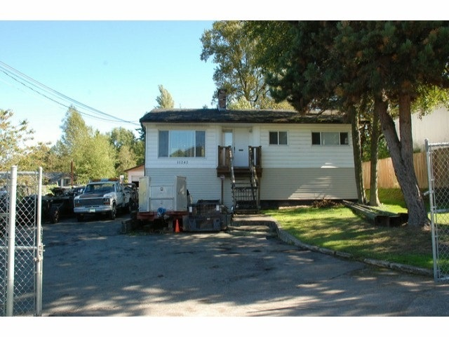 Excellent investment opportunity. Large lot, 11,254 sq, build now, 5600sf house or hold out for big $$$ from a Townhouse developer. Huge 1/4 acre lot with functioning 3 bedroom house and huge shop (fits 6 cars!) Currently rented to a great long term tenant. Entire block will be rezoned to RM-30 allowing for a townhouse development. Phase 1 (75 unit) Townhouse complex is already in the works, this lot will be a KEY part to the furture phase 2 (additional 74 unit) Townhouse complex. You can build 8 townhouses on just this lot! Huge future $$$ potential, Phoenix homes is building townhomes next door! Will to look at trades incl. townhomes or apartments....Offers...