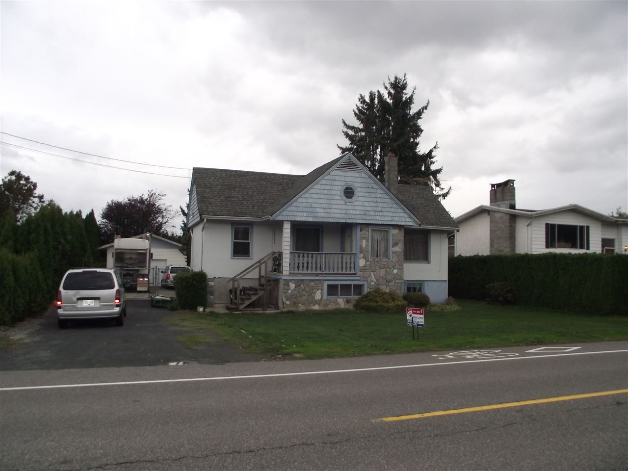 Older home in need of TLC on a large 75' x 114' lot. Detached 20' x 24' shop, fully fenced. Possible subdivision, buyer's to see City of Chilliwack for details. Sardis park location, close to schools an shopping.