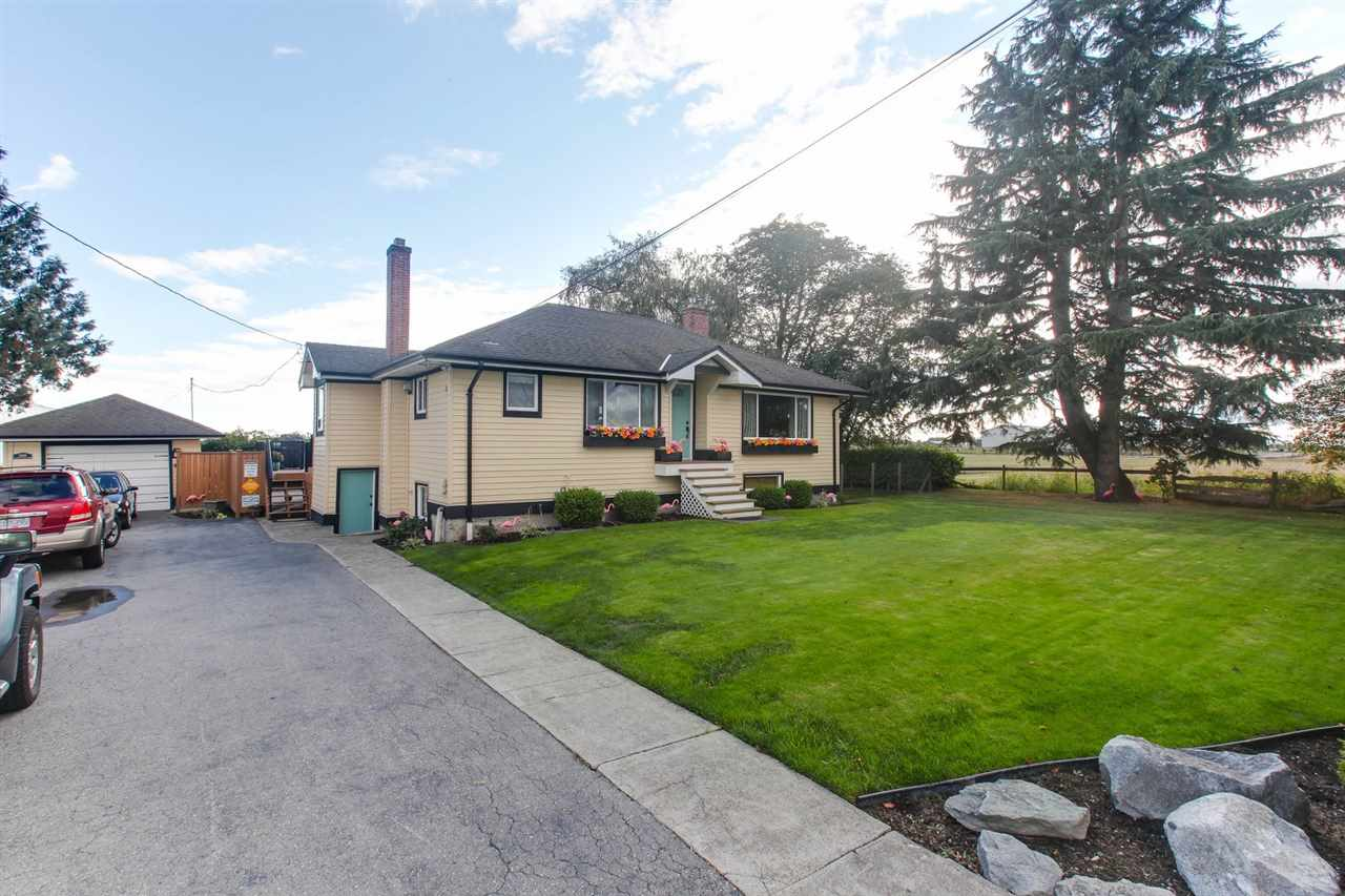 REMARKABLE - 1/4 ACRE in a private rural setting, only minutes to Ladner. This 2100 sq ft  home, on a large 10,800 ft lot includes a separate garage, plenty of parking for RV/boat etc.. Major upgrades include the roof, septic, drainage, windows & vinyl siding.  Lower level has a Family room with  gas fireplace, workshop, flex area and bedroom. Bath on lower level requires finishing. Upper level includes updated open retro-country kitchen, laundry, livingroom and two bedrooms, newer lighting & flooring. Gated rear deck offers south exposure for sunsets and privacy. Home is in wonderful condition with great pride of ownership.