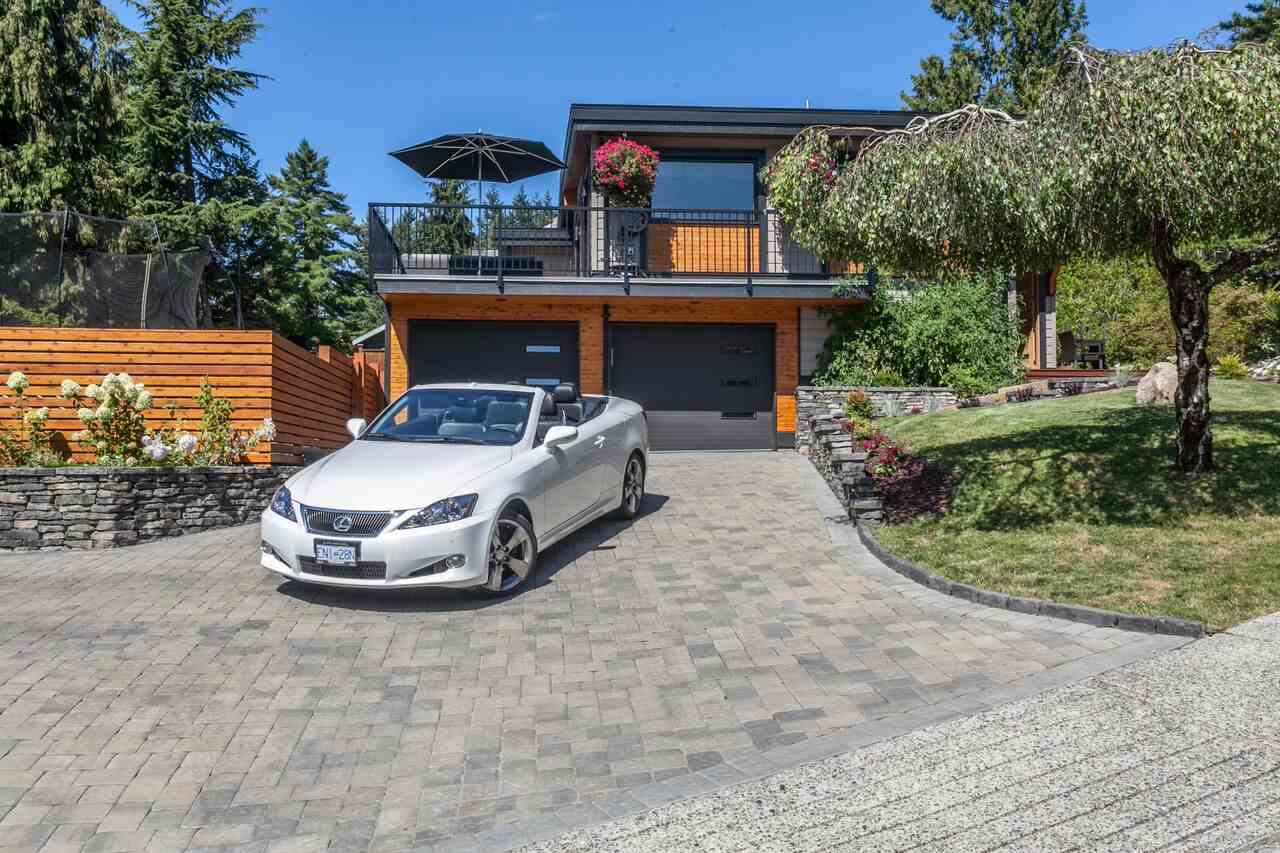 SEE OUR LISTING FILM! Ocean views here for this bright COOL modern gem in Port Moody's family friendly Barber Street area! Our 4 bdrm offers 2529 SF on a generous 8247 SF lot. Completely rebuilt down to the studs in 2015. It's a 2 storey home & aesthetically perfect while built to a high standard. The separate 507 SF 1 bdrm legal suite is well appointed for nanny or tenant. Features include: Wolf 6 burner gas range, Bertazzoni hood fan, Sub Zero fridge, American Standard porcelain farmer's sink, Twenty feet of sliding wood french patio 8 foot doors with black metal clad exterior, Metal cased fir beams, Rue Pierre marble tile herringbone patterned backsplash, marble staggered fireplace, radiant heated floors, 7.5 inch champagne oak floors by Beaulieu, Iron railings, inlet view deck & more!