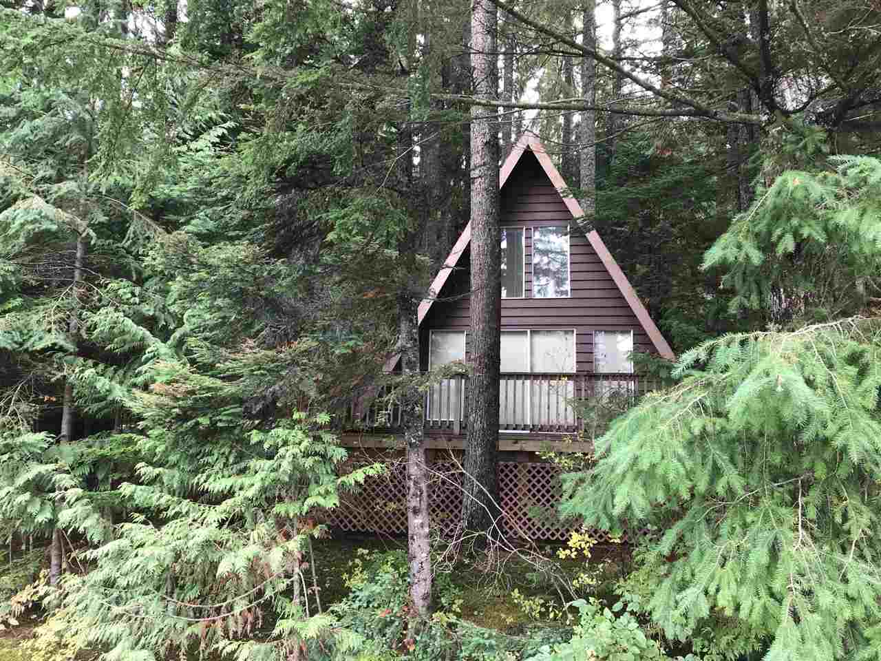 Cute as a button A-Frame on freehold lot! Features 3 sky-lights, 1 bedroom, loft, 3 piece bath, large living room with economical wood stove. Don't miss this one, a great weekend get-away just 2 hours from Vancouver & 1/2 hour from Manning. Situated 1/2 hr from Manning Park and just 15 min from Hope with easy access to trails and highway, makes this solid home ideal for either full-time living or as a four-season recreational retreat. Hiking, snowmobiling, fishing, biking, skiing, and quading, this place is a perfect get-away.