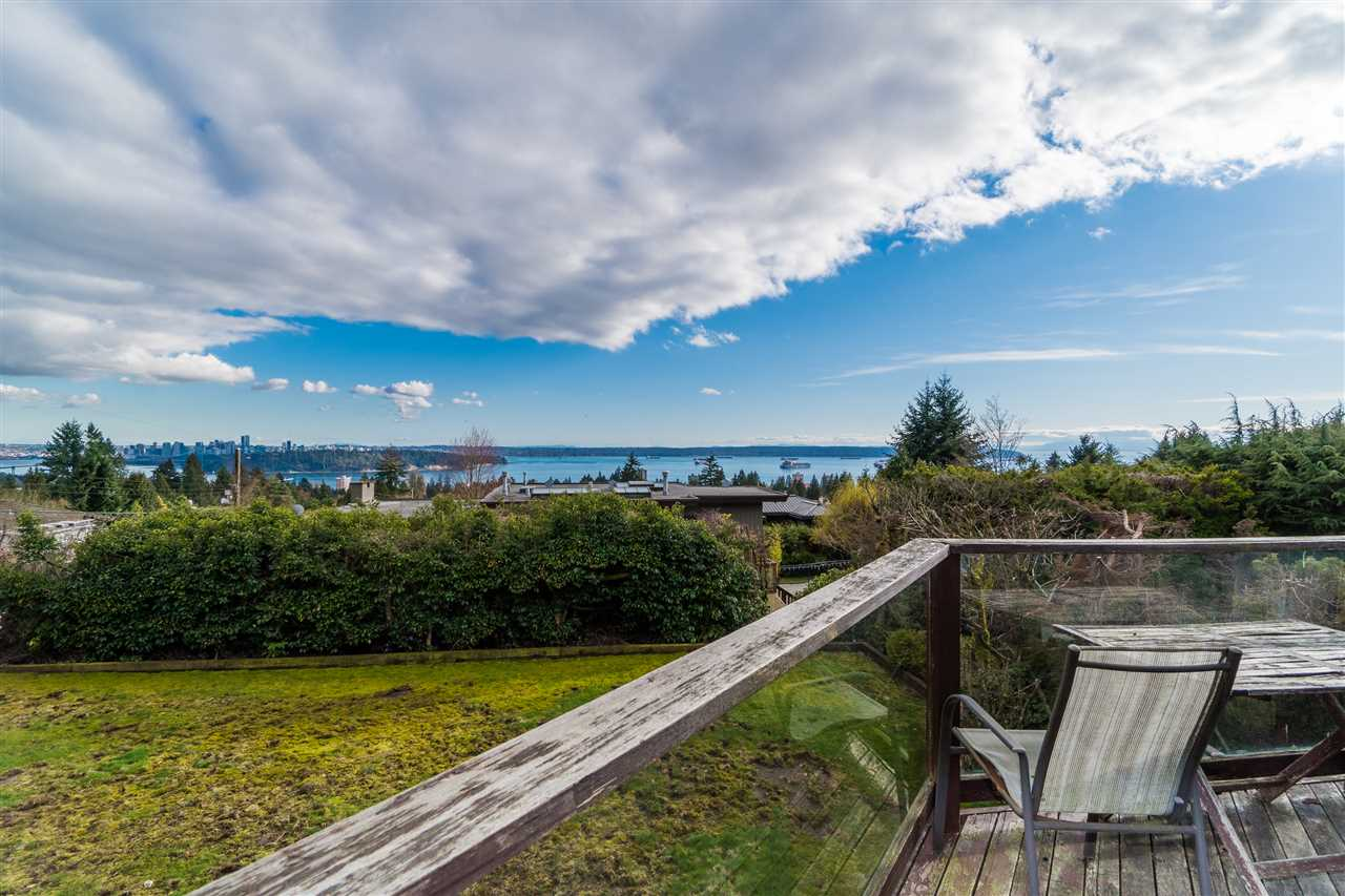 UNOBSTRUCTED breathtaking PANORAMIC water, city & Lions Gate views from this charming Tudor style home sitting on prestigious Upper Ambleside with a 13,440 SF lot. Main floor features entertainment size living, dining & family room, all opening onto an inviting South view deck. Huge modern kitchen has a large work island & bay windows in the eating area. Bright open floor plan on the second level offers 3 spacious bedrooms & a private office with sweeping water & city views. One of the most desirable locations with minutes away from Dundarave Village & West Vancouver Community Centre. BONUS: a large 2 BEDROOM LEGAL SUITE (mortgage helper) on lower level opens out to the private, south facing backyard. View today!
