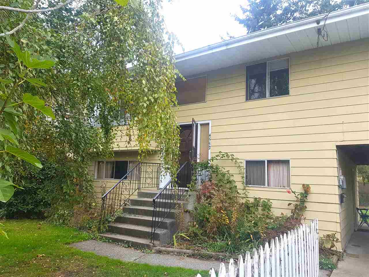 INVESTOR/BUILDER ALERT in WEST LADNER!!!! This prime location property is waiting for you. Hold now and build later on this approx. 6500 sqft rectangular lot with 60' frontage. This 2 level home features 3 bedrooms upstairs with potential to add a 1 bedroom suite downstairs if need be. Currently rented for $2000/month to great tenants. Great location, minutes away from Port Guichon Elementary, Delta Secondary, and 10 min drive to Southpointe Academy. Ladner Village, Ladner Leisure Centre are just around the corner. Easy access to HWY 99 to go to Richmond and Vancouver as well as HWY 17 toward the ferries. Don't miss out!!!