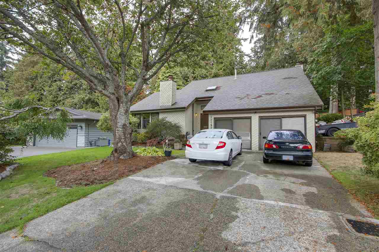 Location on quiet cul-de-sac backing onto creek & greenbelt area. Mature evergreens lend to a beautiful setting for this immaculate, executive home. Architecturally impressive home with double height vaulted ceilings above entry & formal living room. Large kitchen with access to backyard to enjoy this serene & private setting. Plenty of space on the main floor with sizeable family room & double garage converted to living space. Upstairs 3 bedrooms & 2 bathrooms. Easy commuter access, close to schools Ecole Sunshine Hils & Seaquam Secondary (IB Program).