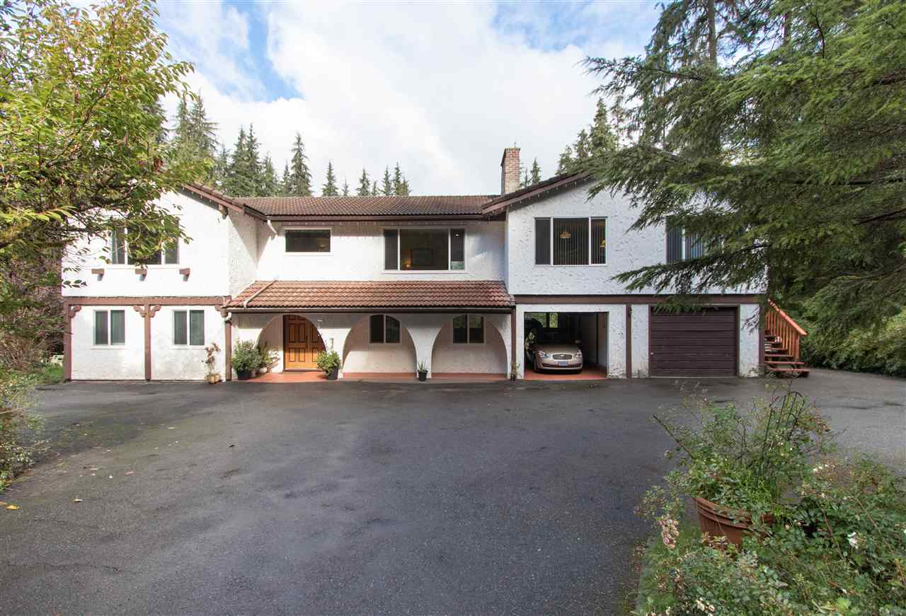 A PIECE OF PARADISE! Large, updated home of over 3000 sqft on almost 1.3 acres set on a no-through street, backing onto tranquil GREENBELT and Kanaka Creek w/ loads of privacy!  Wonderful layout on the main w/ large kitchen open to dining area, formal lvg rm and separate family rm, 3 large bdrms incl Mbdrm w/ full ensuite. Main also features large games room/rec room and den or office space w/ sep entrance, perfect for home based business! Down features 2 more bdrms, big living room w/ cozy wood f/p and sep entrance. Updates incl vinyl windows, newer shaker style kitchen w/ granite counters, stainless appls. Outside boasts a large sundeck overlooking the massive yard, enclosed hot tub area, workshop (approx. 20'x30'), lots of parking for all your vehicles. Close to schools and Whonnock Lake! A MUST SEE!!