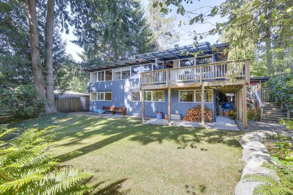 Welcome to a gorgeous, tranquil setting in a desirable family neighbourhood. This exquisite west coast modern post & beam design features vaulted cedar ceilings, skylights & expansive windows throughout the main living area to maximize light & harmonize the home with nature?s beauty. Graced with clean lines, the updated open plan main level w/living, dining & kitchen area highlights a central wood-burning fireplace, wood & tile floors & huge partially covered deck. The 8,330 SF lot w/70? frontage enjoys a serene, south facing level rear yard w/play fort & is fenced & fully landscaped. Updated & modernized in keeping with the original architectural vision, this home has beautiful, timeless style. Lot & Pixilink measures are approximate, buyer to verify.