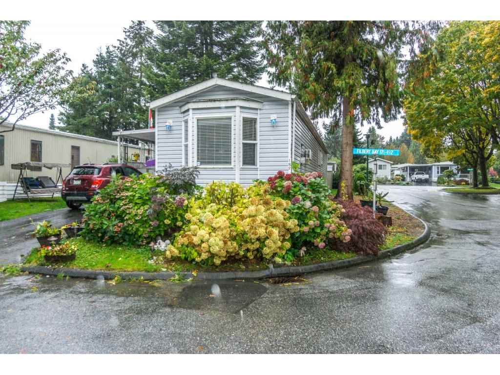 Open House Sun Nov 12 from 2:00 pm - 4:00 pm!    This large 4 bedroom, 2 bath home is over 1,300 square feet, perfect for a growing family. Gas fireplace, bay windows, some updating, covered parking for one vehicle, driveway fits your second vehicle, visitor parking for your guests. Clubhouse, outdoor pool, playground, lots of green space, this is a wonderful community for families. Amazing location... walk to schools, shopping, recreation, restaurants, pubs and coffee shops, it's all a short walk away. Transit at the entrance of the community, quick ride to skytrain and Surrey City Centre. This is a very affordable home! Pet friendly, 2 small pets are okay. Call today to find out more, or to book your private viewing.