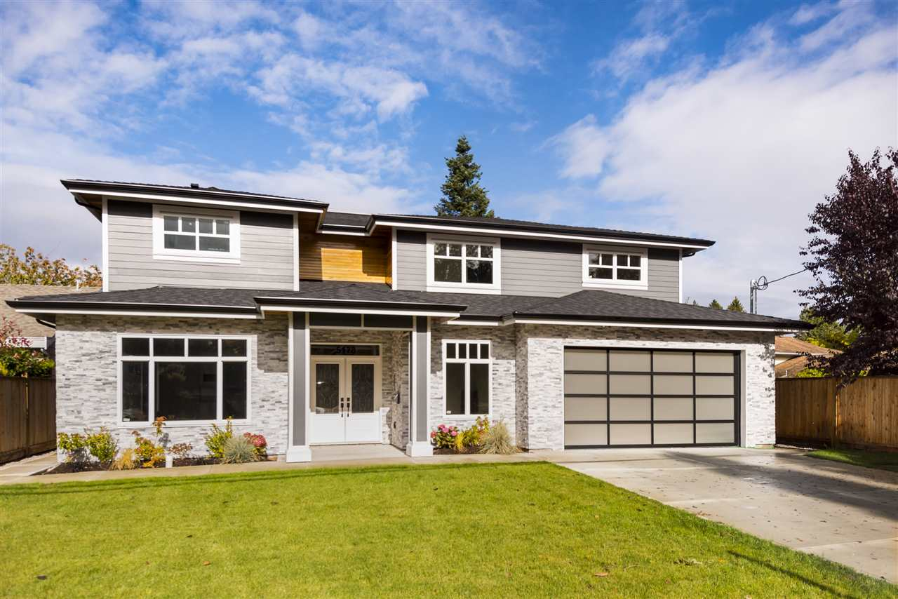 Spectacular BRAND NEW 4,798 sqft luxury residence in Tsawwassen's exclusive Pebble Hill neighbourhood. This sprawling home features a modern, open concept design spread over two levels with high-end appointments throughout and sits on a prime 7,782 sq.ft rectangular lot. Exceptional finishes include hardwood flooring, radiant heat plus A/C, gourmet chef's kitchen w professional Jenn-Air appliances, quartz counters & massive island. Bonuses incl extra large bedrooms each w ensuites & walk-in closets, double garage, second wok/spice kitchen, huge laundry room, walk-in pantry and ability to add side suite if desired (roughed in). Steps to Pebble Hill Elementary and only minutes to South Pointe Academy, new shopping mall, Diefenbaker Park & Point Roberts. 2-5-10 new home warranty.