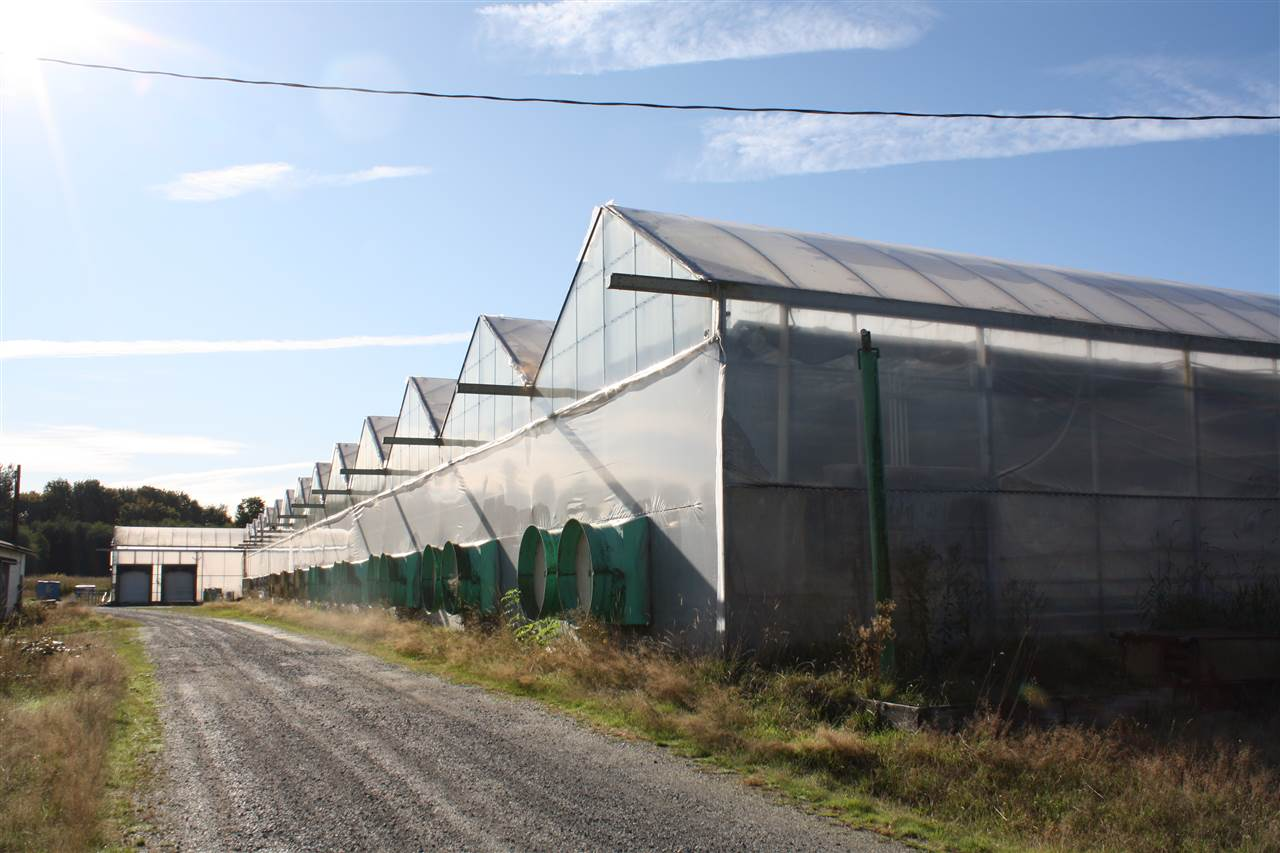 "OVER 14 ACRES in ALR, 3 acres of greenhouse on site. Previous Orchid nursery. 2"" pipe hot water heating throughout. 2 loading docks on site, automatic temperature settings. 198' x 5.5' rolling tables (x228). One 20,000 L and two 90,000L water tanks and also City water. Cummins generator runs the whole farm, 9 zone heating system and an Angus control system will network into your phone and computer. Land optimal for variety of agricultural usage. Value is in the land, not the house structure which is not habitable. 3 of the 14 acres are greenhouses."