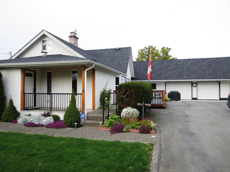 Gated & private 0.87 Acres in Yarrow -3 bed/office + den (wheelchair friendly) HOME! This UPDATED home has large living room w/n/g f/p & new birch kitchen w/eat up bar & nice dining area w/French doors to huge sundeck! Huge pantry/cold room too! Large master bdrm is on main floor, as well as 2nd bedroom. Indoor hot tub area, 2nd bath & huge laundry room/mudroom round off the main floor. Upstairs- office, den & 3rd bdrm. Massive covered back deck for entertaining! Attached dble car garage (24'10x21'), det. dble car garage (25'2x23'4), (30'x10'9) lean-to, (17'3x16') workshop & 2garden sheds! Newer windows & roof! Lots of open space for kids to play & parking for a dozen cars! Gardeners=Green house & raised planters grapevines & more