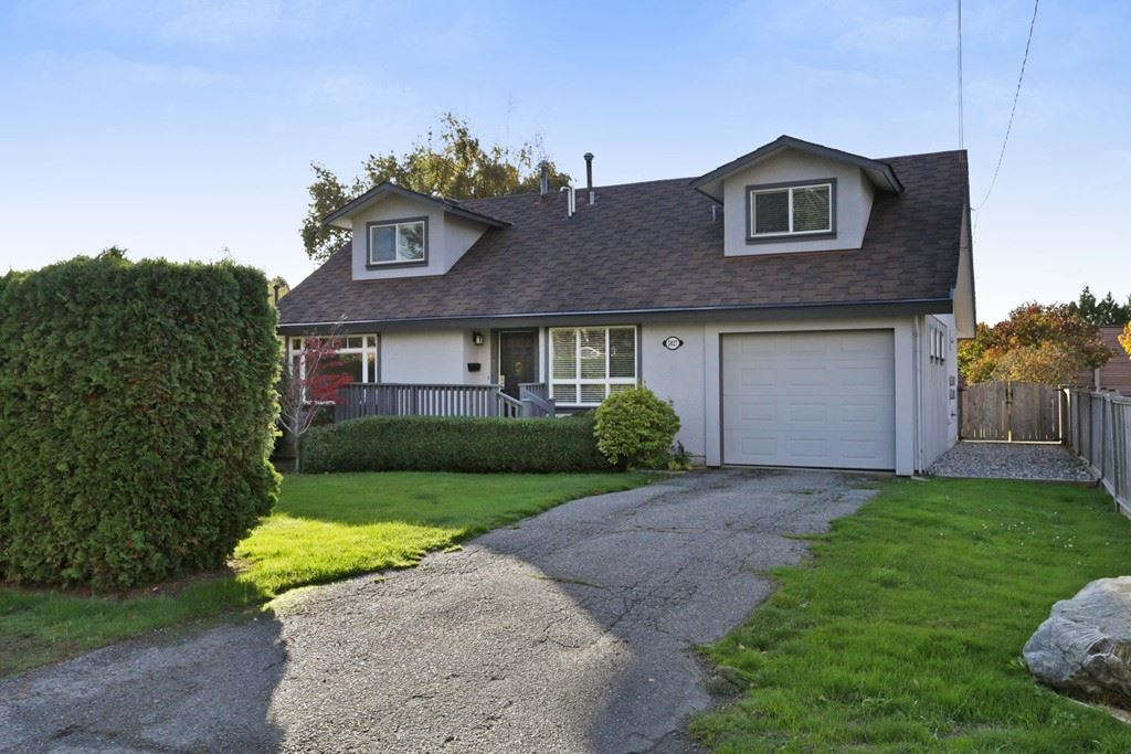Beautifully updated cape cod home on a large 7,500 sqft lot located in the desirable Holly area of Ladner. This home is perfect for the growing family, this home features 4 spacious bedrooms, 2 full baths, new maple shaker cabinets & S/S appliances in the kitchen, new carpets, fresh paint, laminate flooring, gas fireplace & more. Large, sun-drenched west exposed yard is perfect for the kids and features a large cedar deck. Conveniently located near schools, parks, amenities & transit, call today for your private showing. OPEN HOUSE SUN OCT 29 2-4PM!