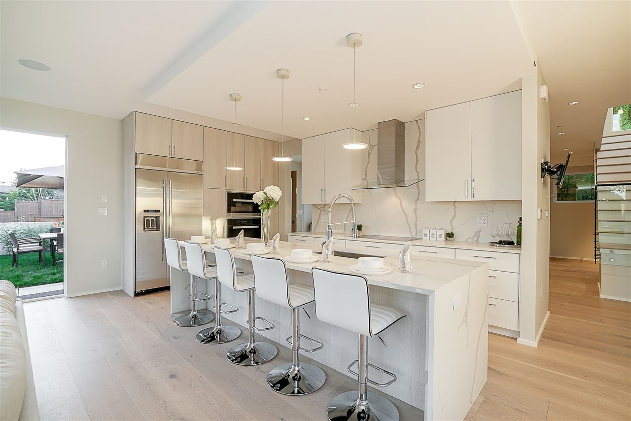 This modern luxurious home is built by Ronse Massey Developments, the 2016 Ovation Award winner. Located in the most desirable neighbourhood in Burnaby; walking distance to Skytrain, Hastings and schools nearby. The best private school - Holy Cross is just steps away. 3815sqft living space with amazing landscaping, PLUS huge south facing windows, tons of natural light. The kitchen is graced with high-end MIELE appliances and modern Spanish cabinets; radiant floor heating & A/C with two gas fireplaces, make you comfortable all year around; All bathrooms use top line brands: GROHE & KOHLER; built- in audio system throughout the house; double garage with EV charger. Full legal suite. Come and check it out!
