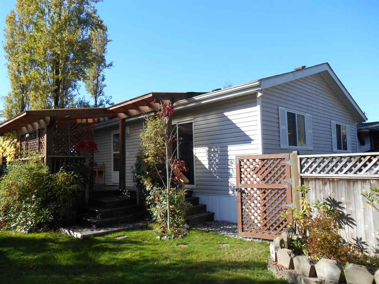 Move in ready 1100 sq ft mobile home with open layout in the main living area. Features laminate flooring, covered sundeck, fully fenced manicured yard and 2 storage sheds for garden tools. Located only minutes from Gibsons and the Ferry Terminal.