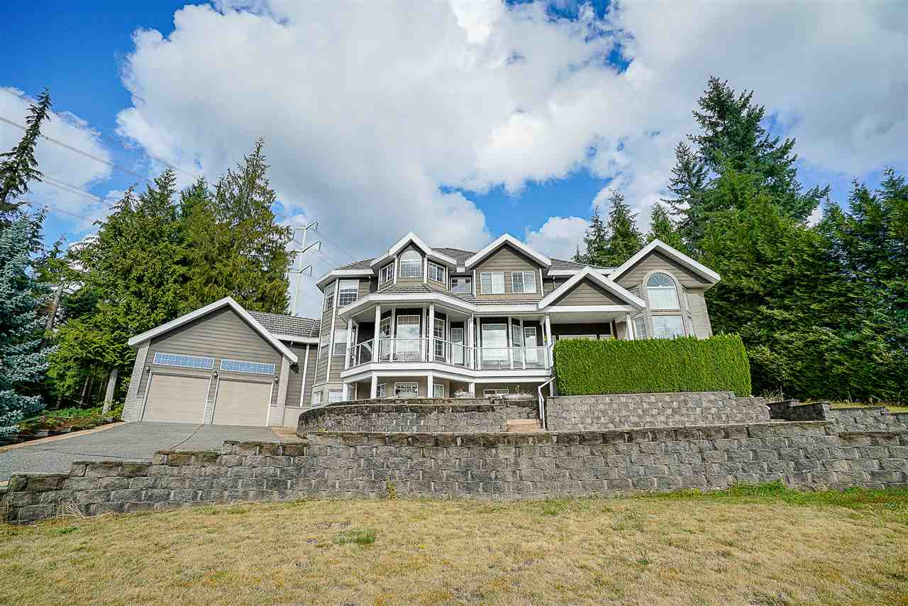 Welcome home to this luxurious 5,800+ sq/ft custom-built mansion situated above the hill of Anmore Estates! Over 1 acre property with breathtaking views of the Burrard Inlet & mountains. Features 18' vaulted ceilings, remote controlled window blinds, central air conditioning, and Japanese-imported hardwood. Master bedroom has huge walk-in closet and ensuite that includes jetted tub & pass-through fireplace. Basement features wet bar, pool table, media room, spacious gym, and wine cellar that can be fit over 3,000 bottles of wine! Attached double garage PLUS another detached garage for RV parking with upstairs workshop ready to be used as your man-cave. Massive backyard with beautiful patio and grass area. Too many features to list.