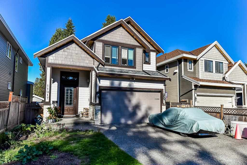 Elegant family home in sought after Annieville, North Delta. Custom designed, spacious layout, 3902.sq ft. home plus 452 sq. ft. double garage built in the year 2013 on 5445 sq. ft. lot. Total 7 bedrooms + 6 bath. Main floor features grand foyer entry, vaulted ceilings, living room, dining room, family room, gourmet kitchen & spice/wok kitchen & nook. Also 1 bedroom with full bath on main floor above 4 bedrooms (2 master with ensuite) and 3 full bath. Basement has mortgage helper 2 bedroom legal rental suite with its own insuite laundry and big 23'6x17' media room with bath. Granite countertops throughout, radiant floor heat. Long driveway for 4 car parking in addition to garage. Steps to Scott rd bus stop and 5 mins drive to Skytrain