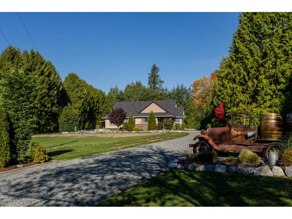 RARE FIND!!! Total privacy. Long gated driveway to Stunning custom rancher with loft, 42x12 RV bay with 12'6 door & 30amp RV plug + 1368 s/f detached workshop with double doors, bathroom & man cave/office. Gorgeous parklike 2.39 acres with high perimeter hedge, manicured lawns & gardens, fire pit & multiple partly covered outdoor living areas. Incredible home with bright open plan & high beamed ceilings. Large great room with feature fireplace & french doors to covered deck adjoining entertaining sized dining room & gourmet kitchen with breakfast bar island. 3 bedrms & den - master bedroom with walk in closet & luxurious ensuite. Large games room above over sized double garage. Perfect spot to put a mobile for mom & dad at the front of the property. Loads of parking, truck & trailer turn around. Zoning allows parking for 3 commercial vehicles. Quiet street - minutes to town. A MUST SEE!