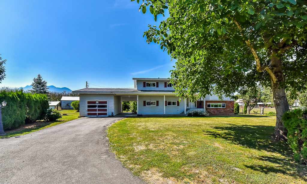Spectacular 5.63 acres, with well maintained outside and well kept inside. This farm status park like property is literally minutes to freeway, downtown or mall, yet very low on taxes. A solid home with 4 bedrooms (or 5) and 2.5 bathrooms, a covered and open deck along with a sun room. Large rec room downstairs with a gas fireplace. Ample storage. A secluded piece of heaven close to town. Continue with nut orchard or bring your farming ideas. Call today for your private tour.