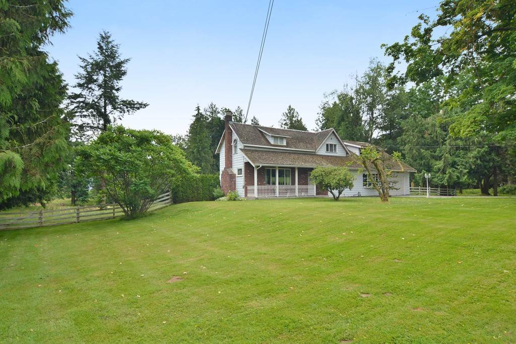 """""""Country living at its best"""". This classic 2 storey, 5 bedroom home. 9 Ft ceilings on main floor. Room for the in laws. The 4,788 acres is one of the nicest acreages you will ever walk. Majestic trees and rolling pasture. This property has farm status (nursery stock). 2nd driveway with access to the hip roof barn. Lots of the room to park RV, Truck and trailers. Close to Mt. Lehman Elementary school, post office, credit union and community hall. On city water. Easy access to Hwy 1 at Mt Lehman or 264th."""
