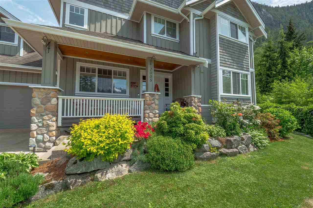 HOT NEW PRICE motivated sellers, fabulous location, flexible flr pln perfect family or Air B&B, classic craftsman styling w/wood accents & hrdwd flrs, high eff gas furn & Navien on-demand (2016), 2 masters (1 on main)+4 bds/4bth, high ceilings, dream kitchen w/dbl wall oven, gas cooktop, granite counters & isl w/seating for 8, walk-out living, main flr is level w/backyard & garden, fully fenced & beautifully landscaped w/hot tub. 450 sq ft heated wrksp w/12 ft ceiling & in-flr radiant heat. X-lrg garage 12' ceilings w/loft storage w/power ramp for car hoist (hoist not incl) fits 4-5 cars (bikes, quads & dirt bikes) blt-in vac, speaker & security system, timberframe covered deck w/gas fireplace off games/media room. 1/3 acre lot backs onto trails & greenspace. OPEN HOUSE SAT FEB 24, 1-4 pm