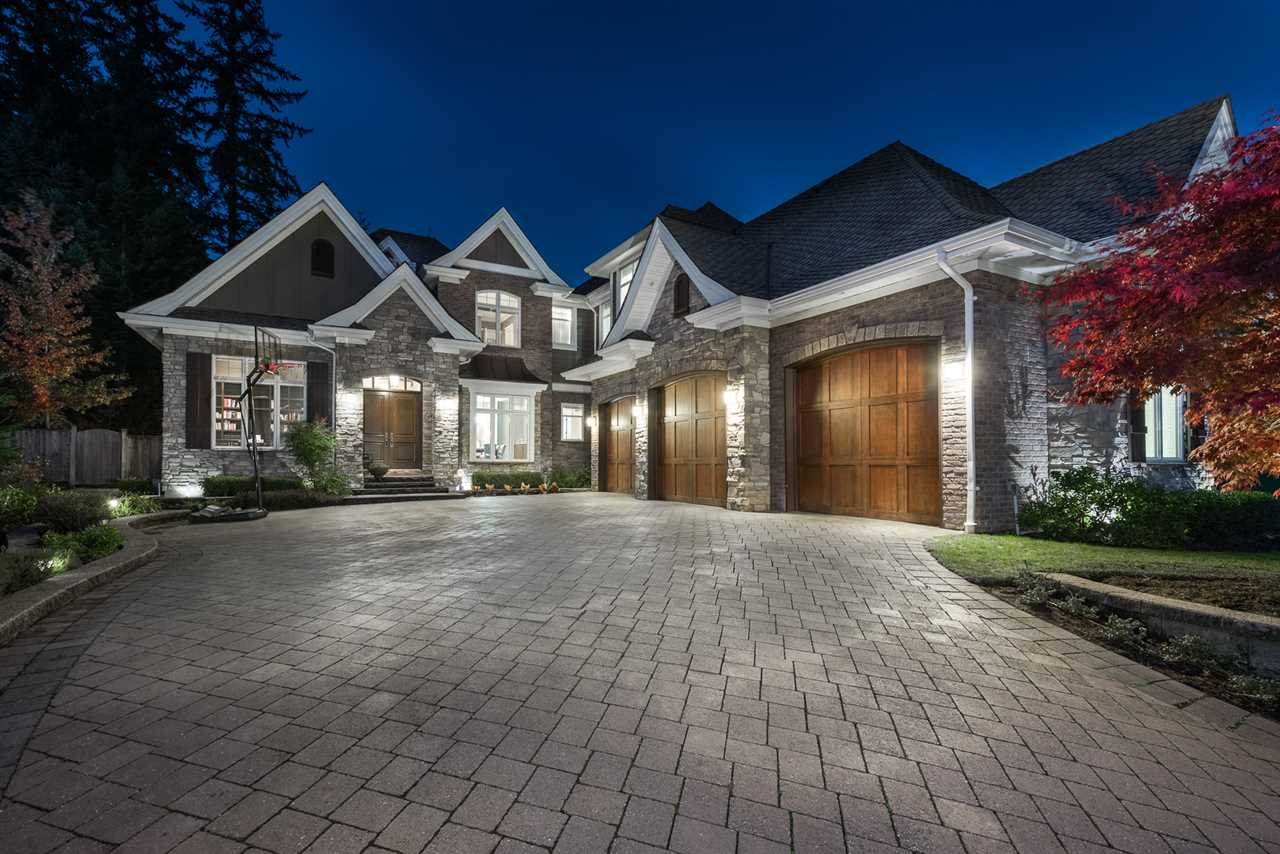 Ravenswood is one of the best family oriented Neighbourhoods in Anmore. Welcome to this custom built home that sits on a half usable acre that is perfect for the family. Outdoor living features f/place, kitchen for entertaining w/waterfall/pond. This home has a park area on one side & protected area at the back for ultimate privacy & lots of sun. Other features that set this home apart from many: a true prof kitchen w walnut cabinets, formal dining, open plan, power blinds, high ceilings, power failure generator. Basement is open & inviting w home theatre & access to outside, bright & cozy for family activities. Large triple garage w. plenty of space for storage. 5 min walk to elementary school, large bdrms & master has a dream ensuite.