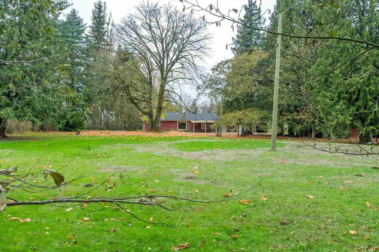 Beautiful 11.3ac adjacent to Vedder River dyke and campground.  Browne Creek bisects this tranquil acreage close to world class salmon and trout fishing.  The modest 1960?S rancher rambles on with hardwood floors and spacious rooms.  3 garages incorporate a workshop.  The 26x49 barn has 2 stalls.  Updates include roofing, siding, flooring and furnace.  The master bedroom is on two levels and has a 2pc ensuite.  Vacant and quick possession is available.