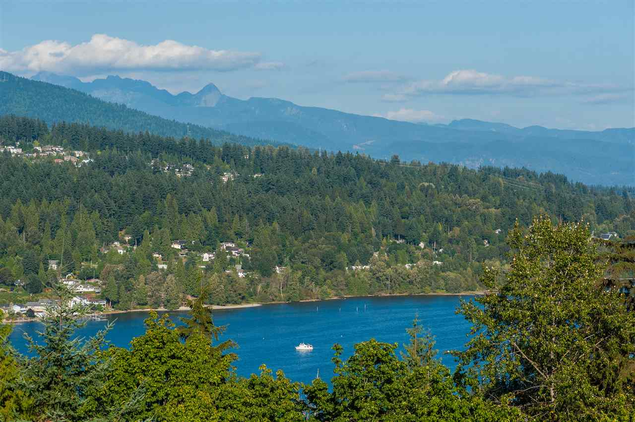 LET YOUR DREAM COME TRUE! COME DISCOVER YOUR 5 BEDROOMS DREAM HOME IN THIS BEAUTIFUL OCEAN VIEW HOUSE IN METRO VANCOUVER. LOCATION - UNBEATABLE! ONLY 30 MINS FROM DOWNTOWN VANCOUVER. PRIVATE & SECLUDED BUT YET CLOSE TO ALL MAJOR HIGHWAYS & AMENITIES LIKE THE EVERGREEN SKYTRAIN LINE, WEST COAST EXPRESS, SFU, GOOD ELEMENTARY & SECONDARY SCHOOLS, SHOPPING ETC. PERFECTLY SITED TO TAKE IN THE STUNNING OCEAN VIEWS OF THE BURRARD INLET & MOUNTAINS. WITH BRIGHT & SPACIOUS LAYOUT, THIS HOME OFFERS PLENTY OF SPACE & LIVING OPTIONS FOR A GROWING FAMILY OR ENTERTAINING OPTIONS FOR THE ELITE. ENJOY THE WARMTH & PEACE THAT THIS HOME PROVIDES OR BRING OUT THE DESIGNER IN YOU TO MAKE IT EVEN MORE EXCEPTIONAL! ** OPEN HOUSE SUN 14th 2-4pm **
