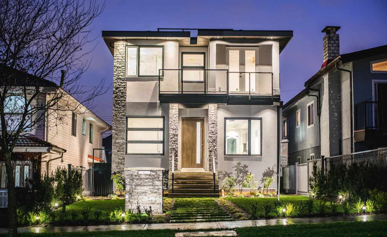 BRAND NEW Custom built home in Vancouver Heights neighborhood sitting on a flat 33' x 122' (4026 sq/ft) lot built by Forward Living Homes and designed by Mona Grewal of Paragon Design Group. Rooftop deck boasts stunning views of Burrard Inlet and North Shore Mountains, natural gas connection for Outdoor BBQ makes this an entertainers delight. Interior with over 2400 sq/ft of well crafted living space. 10' high ceilings, beautiful Italian porcelain tiles, gourmet kitchen with high end Jenn-Air appliances, office/bedroom on main floor. Upstairs has 3 spacious bedrooms, all with en-suites, engineered hardwood flooring and conveniently located laundry. Basement with legal 1 bedroom suite (an excellent mortgage helper). Walking distance to Elem. and High School. Close to BCIT, SFU and DT Van.