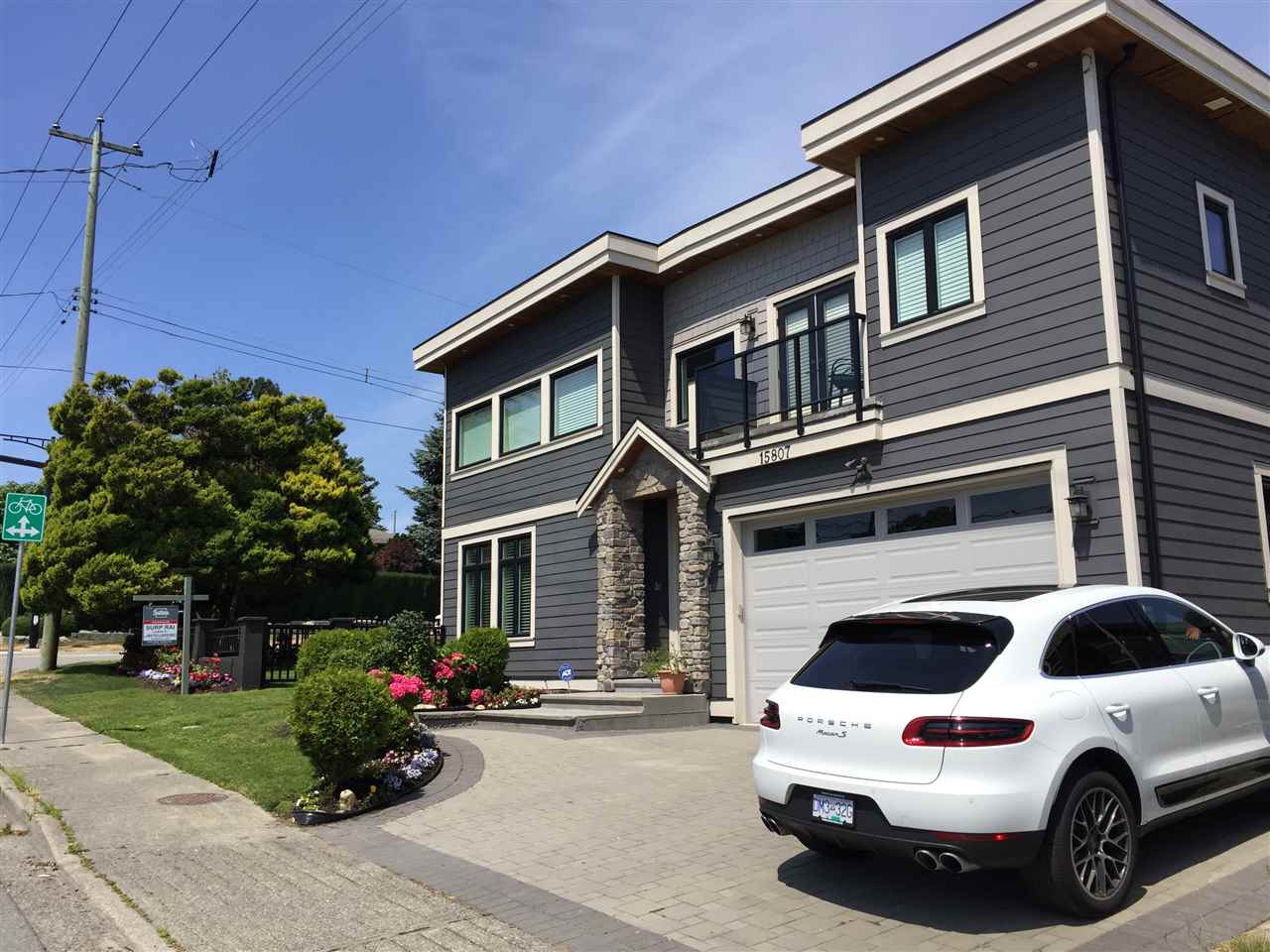 Welcome to this premium custom built 4094 sf home. Total 5 bedrooms (4 with ensuites), 8 washrooms. Lots of natural light, an open concept floor plan with partial southern ocean view. Bright kitchen with accent lighting, granite counters, grand island and stainless steel appliances. Upstairs masterbdrm features a luxury 5 pce bath, walkin closet, private balcony and view of Mount Baker. For your entertaining, the basement boasts a rec-room with wetbar and a media-room. All this + a LEGAL 1 bdrm bsmt suite with laundry & private entrance. Just a short walk to the beach. Near all amenities and the Peace Arch French Immersion elementary school. Call for your private viewing.