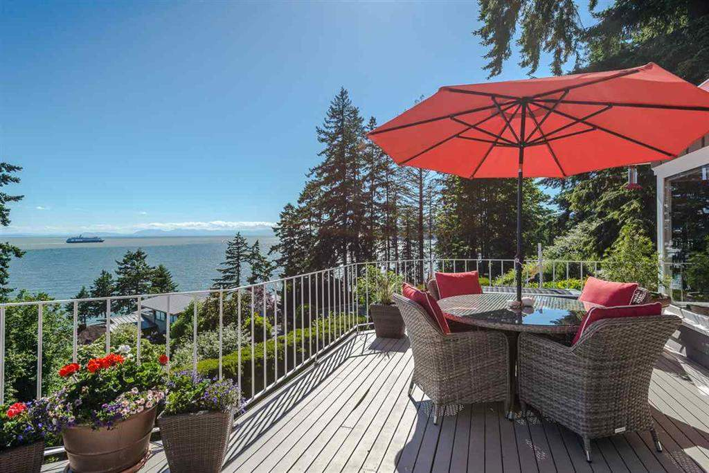 Exquisite West Bay Craftsman with world class views of ocean & Vancouver Island! The main level boasts a well appointed gourmet kitchen that opens to the living & dining rooms that all enjoy pristine hardwood floors. The upstairs is entirely designated to a beautiful master bedroom & ensuite with walk in closets and, like every floor in the house, the outlook & views are spectacular! Downstairs features a self contained in-law suite that gives plenty of options as to how this home can be used. The exterior patio and balconies further showcase the privacy and ocean vista while you enjoy the gorgeous garden & outdoor space in this spectacular coastal setting. Open Sun. 2-4