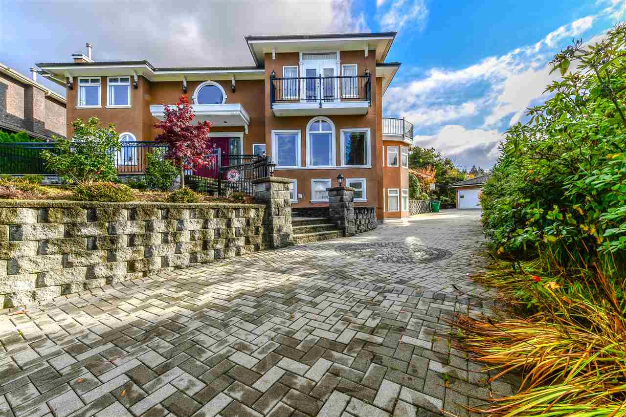 Executive living on North Burnaby's premier street. Unbelievable view of ocean & mountains. This home sits on 16,600 sqft lot with 4700 sq ft of living. New Landscaping/Basement Suite/Hot water tank. Features: wok kitchen, giant chef's kitchen with commercial grade appliances, raised maple cabinets, granite, wine fridge, oak hardwood & quartz flooring throughout, guest bedroom on main with ensuite bathroom. Recreation room could be converted to nanny room, private master bedroom with balcony & huge walk in closet, fruit trees, gazebo, detached garage, huge patio, gated driveway & more.