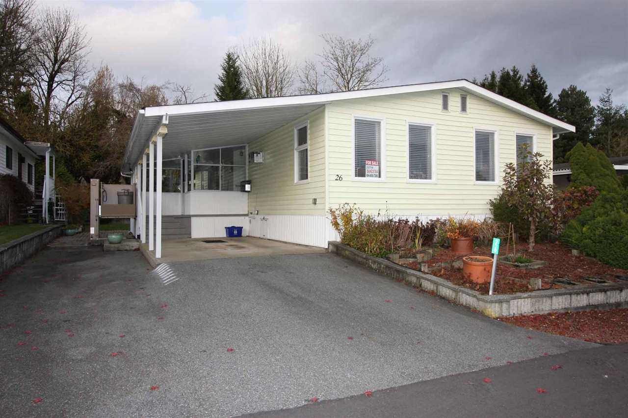 """Pioneer Park! VIEWS VIEWS VIEWS!! This very well maintained 2bedroom+2full bath unit is in a prime location in the park! Up on the hill with lovely views of the mountains and valley to the south. It is a MODULAR home with 2x6 construction, fully drywalled and well insulated, 1250sqft PLUS 200sft sunroom and large shop around back. New Vinyl windows and blinds plus wheel chair friendly. There is a good sized back yard backing onto green space, private and close to the park if the dog needs a run. Minutes to US Border, Langley & White Rock. $300/month. RV Parking avail. Strictly 55+. 2small pets ok. (dog 20""""at shoulder)"""