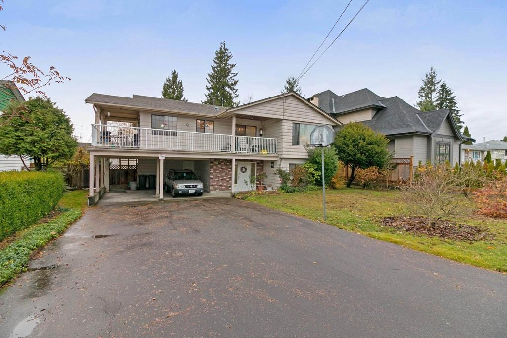 Terrific 3 BR family home with easy access to Skytrain & shopping. Newer roof approximately 2010. This home is located on quiet street. The upper level has a large living room w/gas fireplace, formal dining area, a sunny bright kitchen w/eating area, there are 3 good size bedrooms & 1.5 baths. The lower level has a bright 1 bdrm suite all above grade. Bonus: There is an outdoor lift, for access between levels. Enjoy the fenced private & sunny rear yard,or your morning coffee on the sundeck. Shows well. ***First viewings open house Saturday & Sunday, Nov 25th & 26th 2-4pm.***