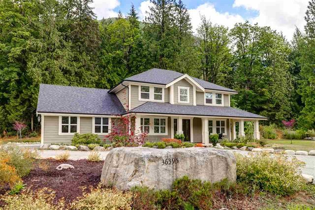 This farmhouse style home sits on 2.69 acres in an exclusive subdivision of acreages, 15 min to West Coast express and downtown Mission. Bus stops on St. for Hatzic Elementary & High Schools. Cascade Falls 6kms away, not to mention an abundance of creeks, lakes & dirt biking trails in  your backyard! No details spared in this 3 bedrooms home, extensive high end finishes, top line appliances, including a full fridge/full freezer combo and double wall ovens. The master suite features his and her walk in closets and a huge walk in tiled shower. Enjoy exquisite coffered ceiling feature in the foyer. This house was built with attention to detail, including endless storage. Beautiful wrap around porch with handcrafted pillars, wood soffits, cedar flooring and arched openings.